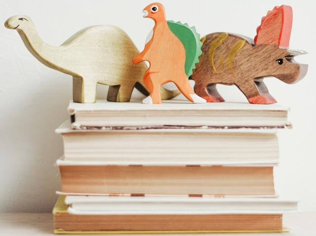 three wooden dinosaur